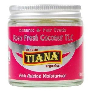 A small clear glass jar containing white coconut moisturiser with metal lid. A pink label shows Tiana Rose Scented Anti Ageing moisturiser.