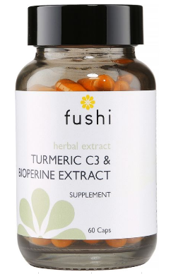 A brown glass jar with black lid. White label shows Fushi Turmeric c3.