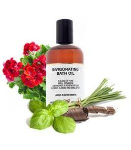 brown plastic bottle surrounded by herbs white label showing amphora invigorating bath oil