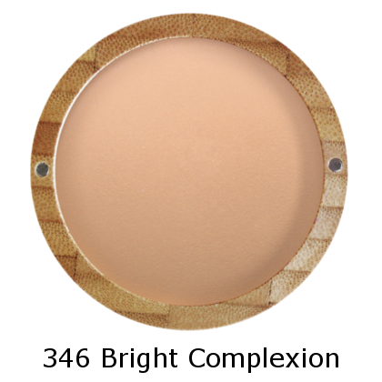 Shade of Bright Complexion mineral cooked powder 346, in bottom half of bamboo case
