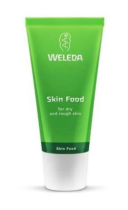 A green squeezy tube with white cap. Label shows Weleda Skin food.
