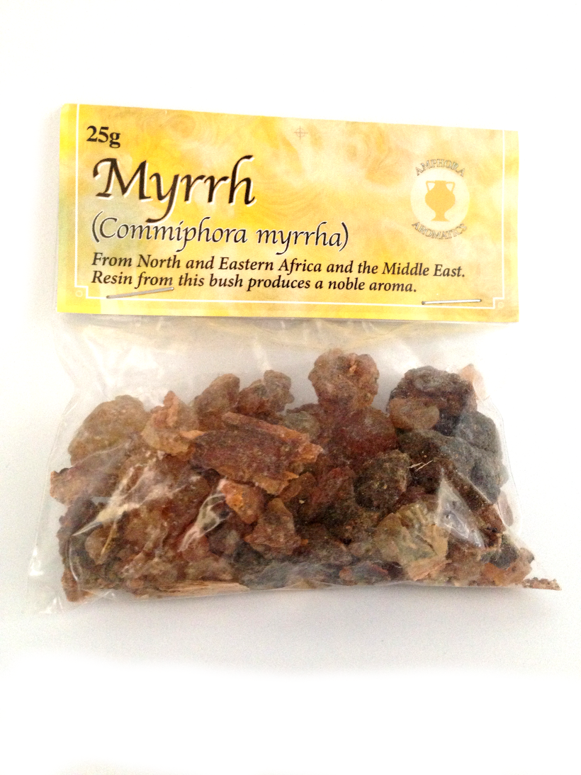 A small plastic packet with brown resin chunks. Yellow card attached showing Myrrh.
