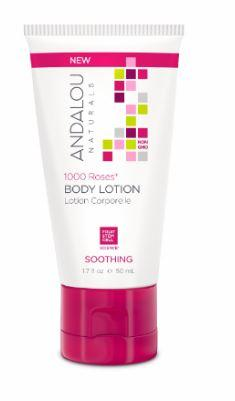 A white plastic squeezy tube with bright pink flip top cap. Label shows andalou 1000 roses soothing body lotion. White and pink box packaging.
