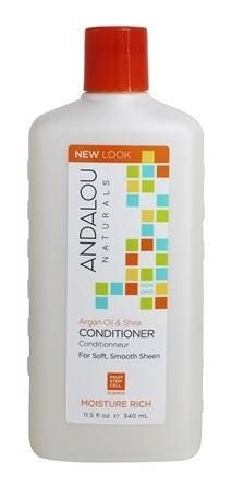 A white bottle with orange cap. Label shows andalou argan & Shea moisture rich conditioner.