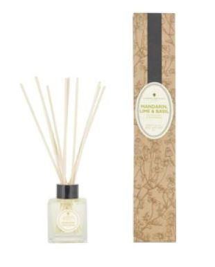 natural brown decorated box and clear glass bottle with ratten reeds labelled amphora mandarin basil and lime reed diffuser