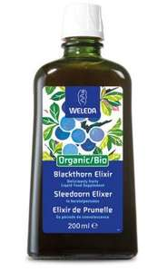 A green glass bottle with white cap. Blue labelling shows Weleda Blackthorn elixir