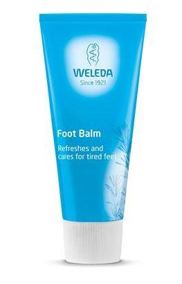 A blue squeezy tube with white cap. Labelling shows weleda foot balm.