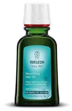 A green bottle with white cap. Blue label shows weleda nourishing hair oil.