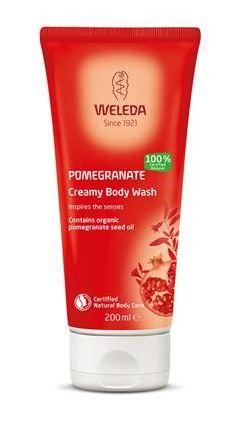 a red squeezy tube with white flip top cap. Label shows weleda pomegranate creamy body wash.