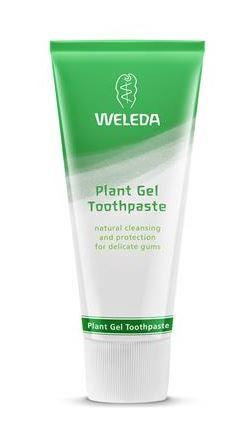 a green and white squeezy tube with white cap. Label shows Weleda Plant Gel toothpaste.