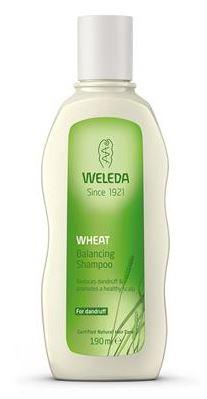 A white plastic bottle with white cap and green label. Label shows weleda wheat balancing shampoo.
