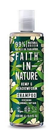 A clear plastic bottle and cap, decorated label with graphic images of green hemp leaves and cream flowers. Label shows hemp and meadowfoam shampoo.