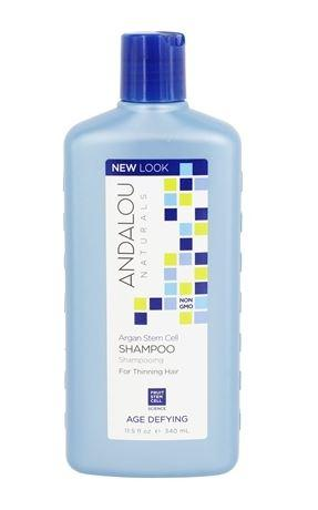 Blue plastic bottle and blue cap. Label shows andalou argan stem cell age defying shampoo