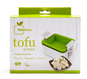 A white and green box with an image of green tofu press on kitchen work surface and chopped tofu.