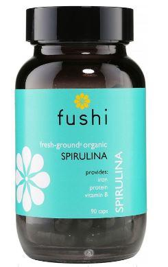 Brown glass jar with black lid. Label shows fushi Spirulina.