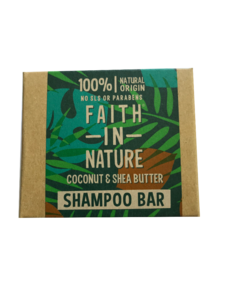 A natural brown card box packaging with tropical green leaf pattern. Labelling shows Faith in Nature coconut and shea butter shampoo bar