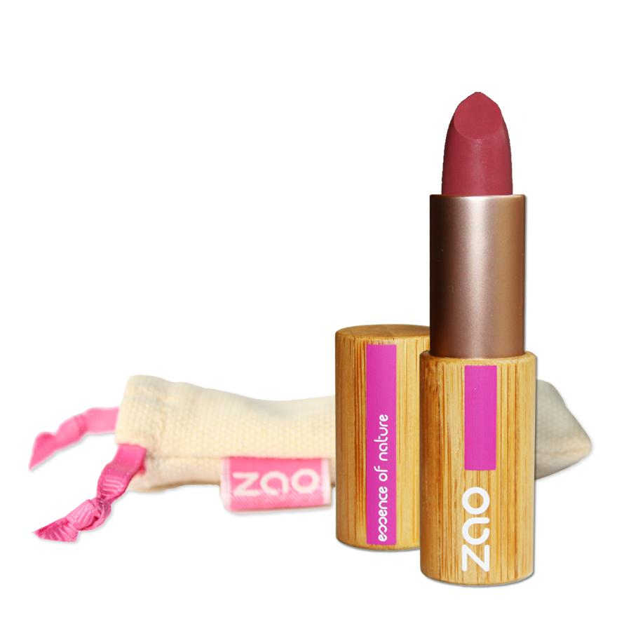 open old pink lipstick in a bamboo lipstick case, natural cotton pouch shown behind, label shows zao