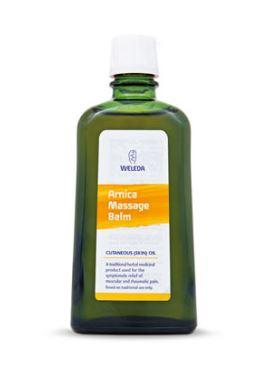 green glass bottle with white cap. white and orange label shows weleda arnica massage balm 200ml.