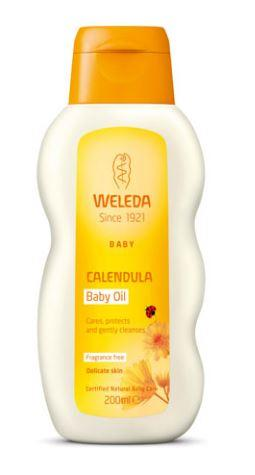 A white plastic bottle with orange cap. Orange labelling shows Weleda baby calendula baby oil.