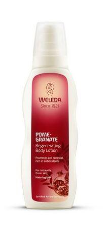 A white bottle with dark red label and white cap. Label shows weleda pomegranate regenerating body lotion.