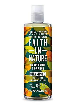 Clear plastic bottle with white cap. Decorative  dark label with round orange images and green leaf images. Label shows faith in nature orange and grapefruit shampoo.