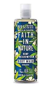 A clear plastic bottle and cap, blue label with graphic images of  cream flowers and green leaves. label shows faith in nature hemp and meadowfoam body wash