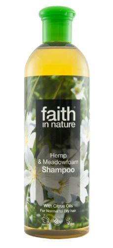 A clear plastic bottle with green cap, label has photo image of  hemp plants, green leaves and white flowers. Label shows hemp and meadowfoam shampoo.