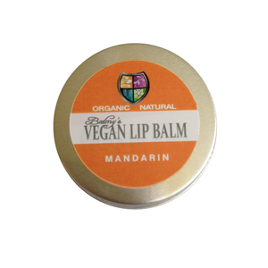 A round silver aluminium tin with orange and white label. Label shows Balmy's vegan mandarin lip balm.
