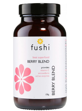 A brown glass jar with black lid. White label shows Fushi best superfood berry blend.
