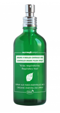 green glass bottle with silver atomiser top. White text labelling showing organic respiratory pillow spray.