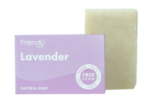 A lavender purple coloured card soap box with white text labelling showing friendly soap lavender natural soap. Rectangular natural cream bar of soap stood next to packaging.