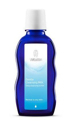 A blue bottle with white cap. Label shows weleda gentle cleansing milk.