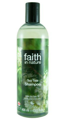 a clear plastic bottle with black cap. Photo image on label of tea tree flowers and leaves. Label shows faith in nature tea tree shampoo.