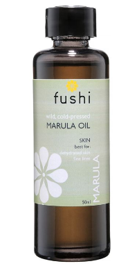 A dark brown glass bottle with black cap. Natural coloured label with white flower image showing Fushi Marula oil.
