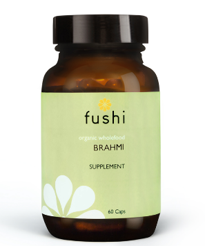A brown glass jar with black lid. Label shows Fushi Organic Brahmi veg caps.