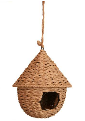 A hanging round rattan bird house, with conical shaped roof and small round entry hole.