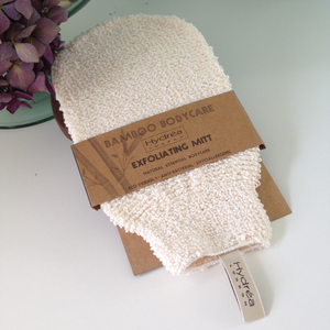 A cream textured fabric cleansing mitten, with natural brown card wrap around showing hydrea bamboo exfoliating mitt.