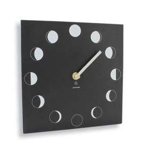 black  slate like square clock with white hand showing moon phases around it