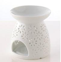 White ceramic oil burner with space under for tea light and shallow bowl top. Decorated with floral fretwork design