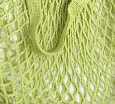 close up of lime coloured cotton string shopping bag