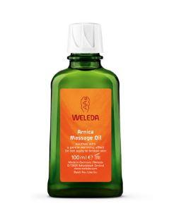 green glass bottle with white cap. label shows weleda arnica massage oil.