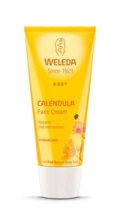 A yellow squeezy tube with white cap. Orange labelling shows weleda baby calendula face cream.