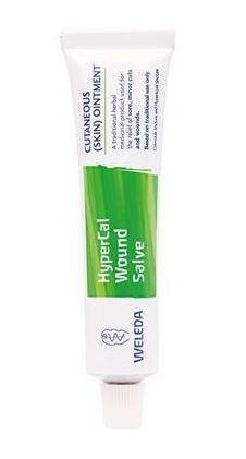 A small white tube with white cap. Label shows weleda hypercal wound salve.
