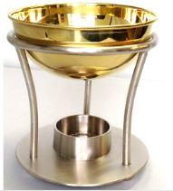 A pewter based oil burner with large brass bowl
