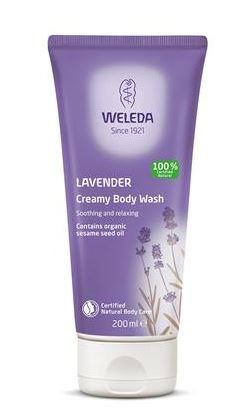 A purple squeezy tube with white cap. Label shows Weleda lavender creamy body wash.