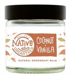 A clear glass jar with black cap, contains white balm. White label with brown text shows native unearthed vanilla and coconut deodorant balm.