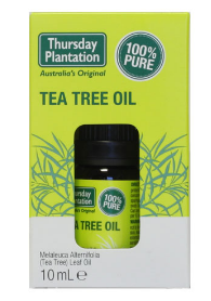 A brown glass bottle with black cap, shown inside green card board packaging box. Label shows Thursday Plantation Tea Tree oil.