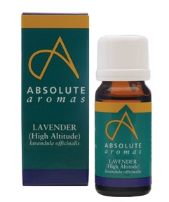 A brown glass essential oil bottle with white cap, stood next to box packaging of green and blue. Label shows absolute aromas lavender high altitude.