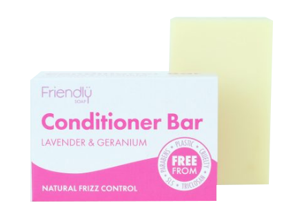 A pink and white rectangle card soap box with Pink Text Labelling, next to a natural cream bar of soap. Labelling shows friendly soap conditioner bar lavender and geranium.