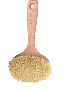 A natural light wood colour beechwood body brush, short handle, oval brush head with long cream bristles